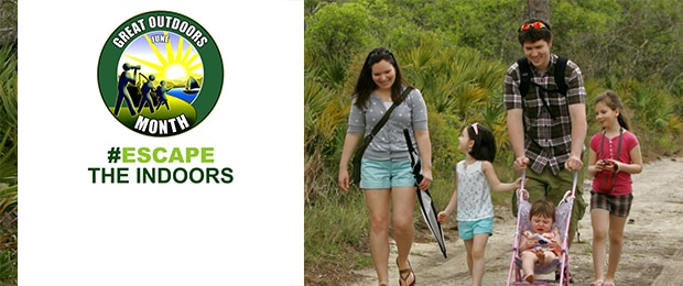 Photo of a family walking on a trail. Logo for Great Outdoors Month with the hashtag escape the indoors.