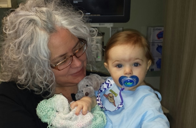 Robin holds Asa in a hospital room during one of his hospitalizations at a year old.