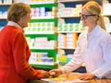 Woman consults with pharmacist