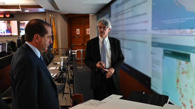 Secretary Alex Azar receives a briefing from Assistant Secretary for Preparedness and Response Robert Kadlec in the Secretary's Operations Center at HHS