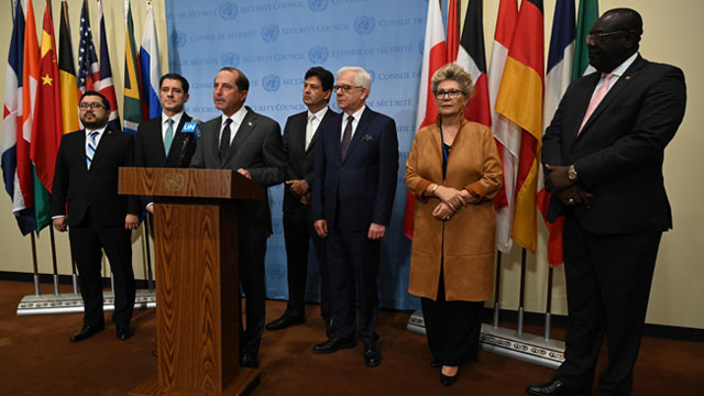 At the United Nations General Assembly, Secretary Alex Azar at a podium standing with five other men and one woman
