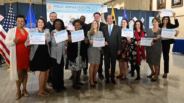 Secretary Alex Azar with HHS employees holding up certificates during Public Service Recognition Week activities at HHS