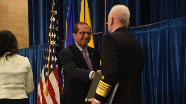 Secretary Azar greets Adm. Brett P. Giroir, M.D. at the inaugural meeting of the  The Pain Management Best Practices Inter-Agency Task Force.