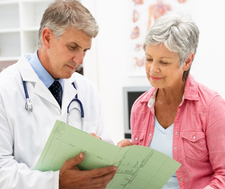 Woman reviews her chart with her doctor