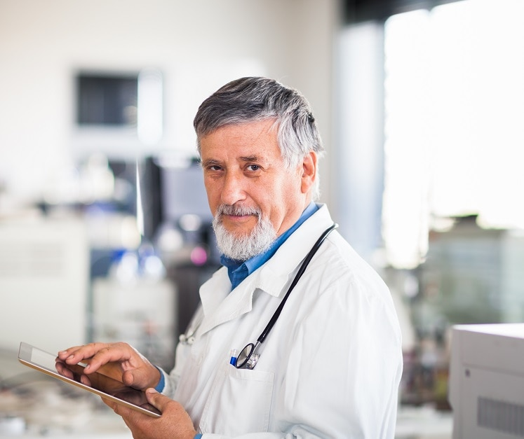 Physician holding a tablet