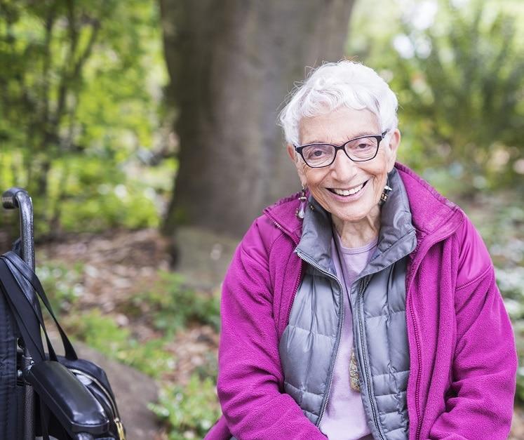 Older woman sitting outside.