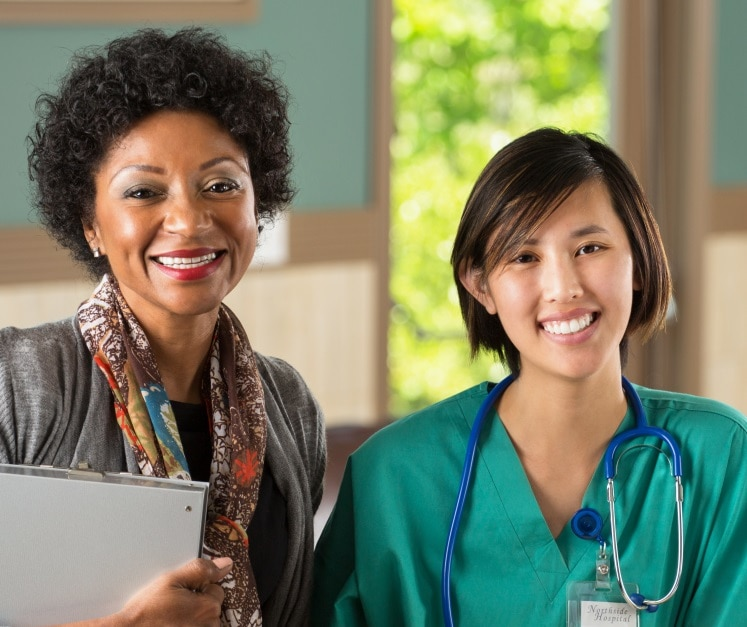 A social worker and health care provider smiling.