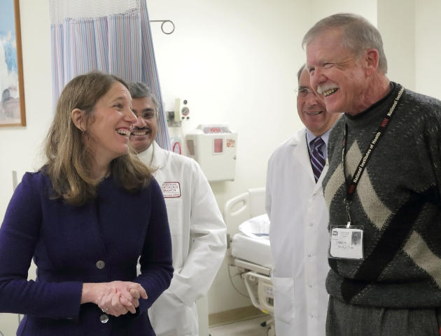 Secretary Burwell meets with Don Dean, front right, at the National Institutes of Health. Don Dean is a patient at the NIH who has benefitted from the work of precision medicine.