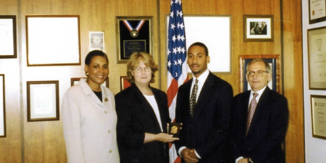 Derrick Jackson is sworn in as a special agent. Carolyn Jackson (far left), June Gibbs Brown (middle left), Derrick Jackson (middle right), Jack Hartwig (far right).
