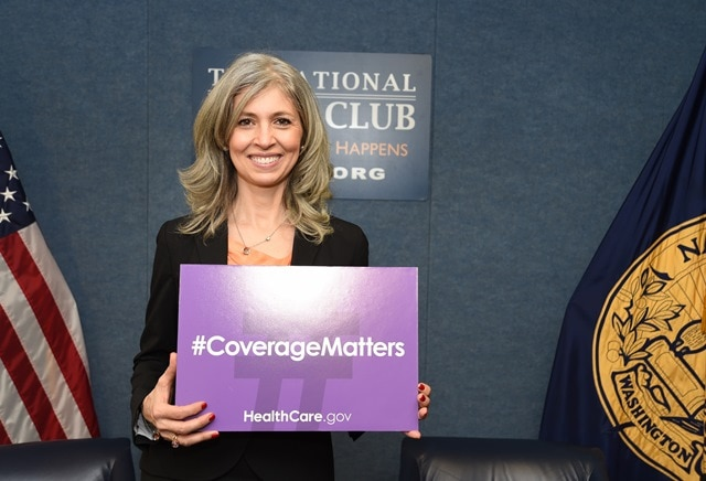 Chiara D'Agostino holds a #CoverageMatters sign at an Affordable Care Act event at the National Press Club in Washington, D.C.