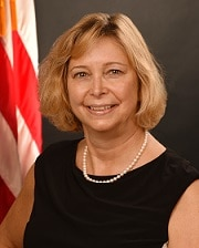 Portrait of Christine Major with U.S. flag in background