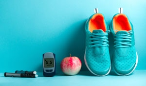 Photo of health prevention techniques shows a pair of athletic shoes, an apple, and blood sugar monitoring devices