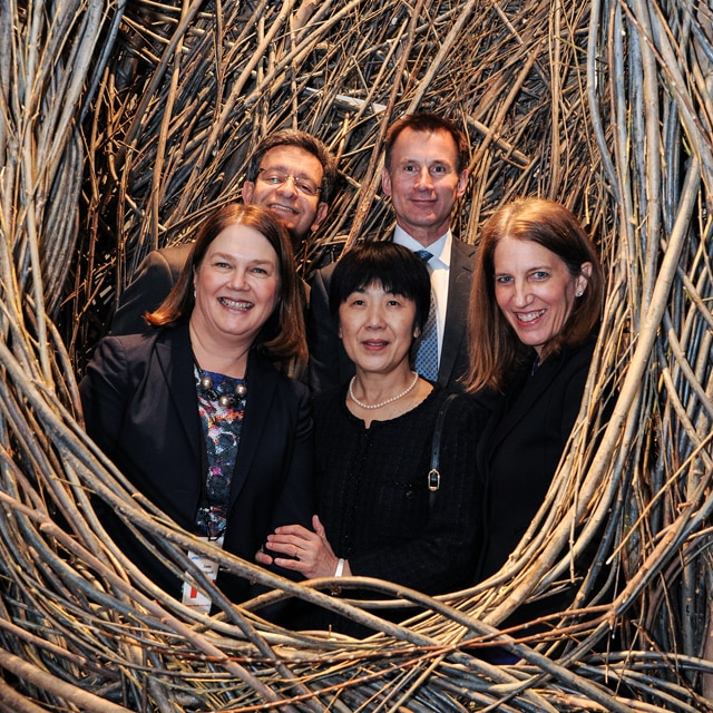 "Taking a moment for a group photo in Patrick Dougherty's ""Shindig"" with Jane Philpott of Canada, Pablo Kuri Morales of Mexico Naoko Yamamoto of Japan and Jeremy Hunt of the United Kingdom. Don't worry. We made it out in time to see the next exhibit."