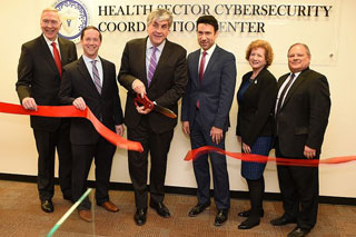 Deputy Secretary Eric Hargan and other HHS leaders cut the ribbon for the new HC3.