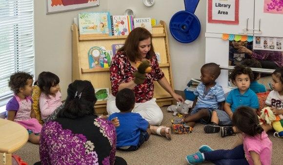 Head Start teacher shows puppet to children