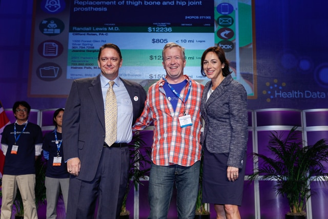 Karen DeSalvo (Office of the National Coordinator for Health Information Technology) (right) and Dwayne Spradlin, former CEO of the Health Data Consortium (left) announce Dave Vockell, CEO of software company Lyfechannel, as first place winner of the 2014