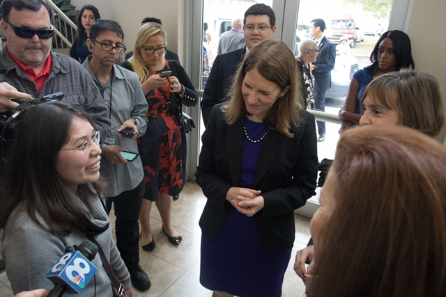 Mariafernanda Davila (bottom left) talks to HHS Secretary Burwell during a 2016 Open Enrollment event in Tampa, Florida on Sunday, January 10, 2016.  Photo by Gregg Pachkowski.