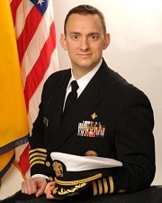 Portrait of Michael Schmoyer with U.S. flag in background