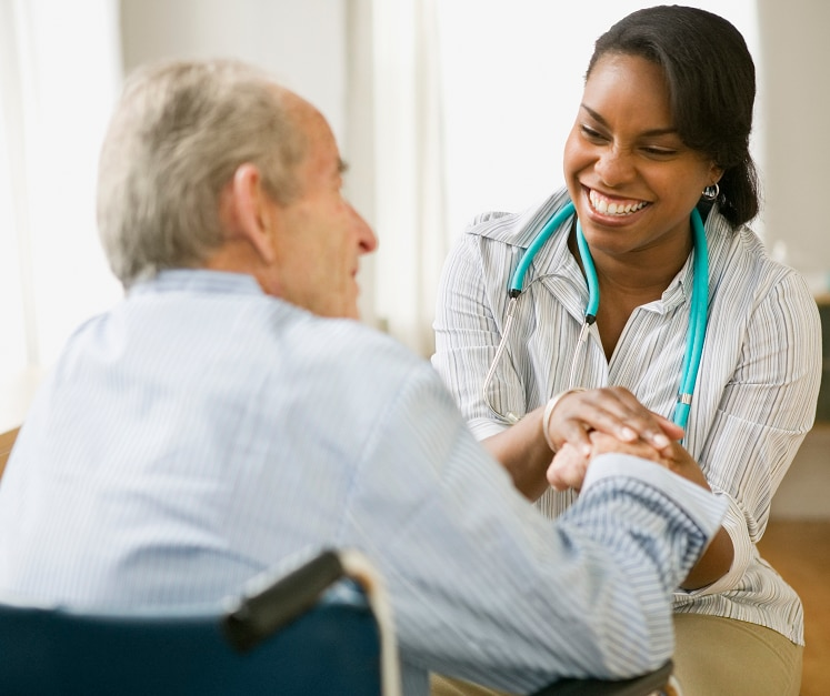 A doctor talking to an older patient