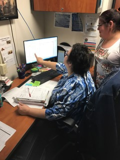 Medical support assistants, Delia Howling Wolf and Komiko Garcia, at Fort Berthold Reservation in western North Dakota.