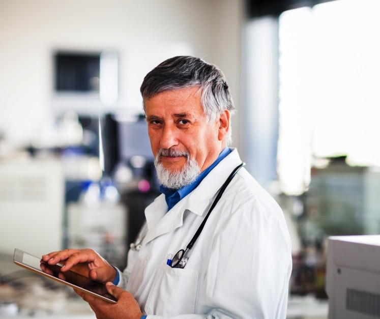 Physician looking at an electronic health record on his tablet