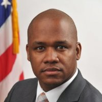 Portrait of Rasheed Williams with U.S. flag in background