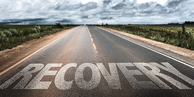 "The word ""recovery"" on a long road"