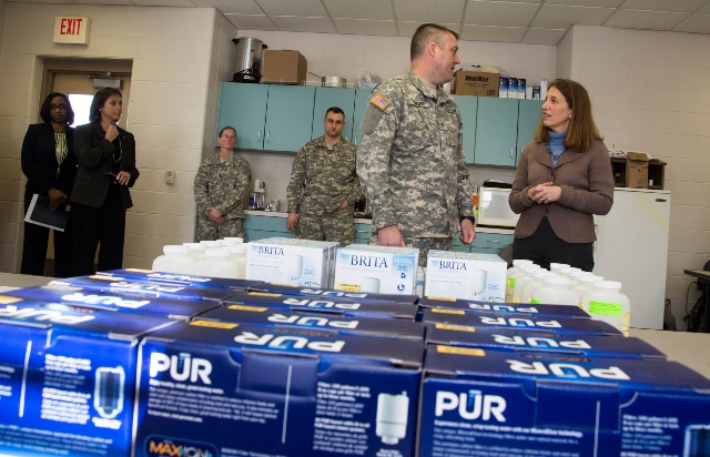 HHS Secretary Burwell talks to Sergeant Allen Thorpe, U.S. Army, National Guard, during a stop at Fire Station No. 5 in Flint, MI.