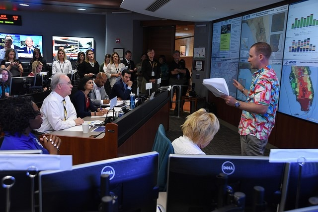 HHS Secretary Price receiving a briefing on Hurricane Irma response in the Secretary's Operation Center (SOC)