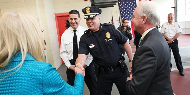 Manchester Police Chief Nick Willard greets Kellyanne Conway during a visit from Department of Health and Human Services Secretary Tom Price at Central Fire Station concerning the opioid epidemic. Concord, New Hampshire. May 10, 2017. Photo by: Jill Brady