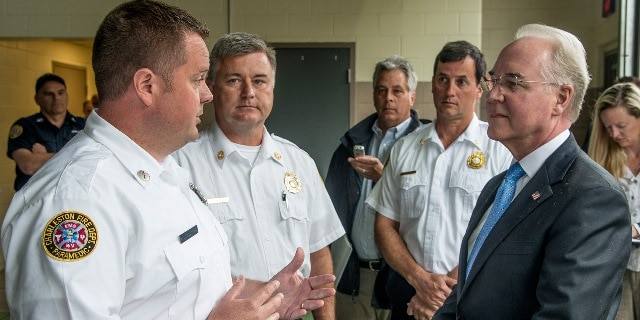 Health and Human Services (HHS) Secretary Thomas E. Price, M.D., right, discusses the opioid epidemic with Charleston Fire Dept. Lieutenant David Hodge, left, during his visit to West Virginia on May 9, 2017. Photo Credit: Bob Bird.