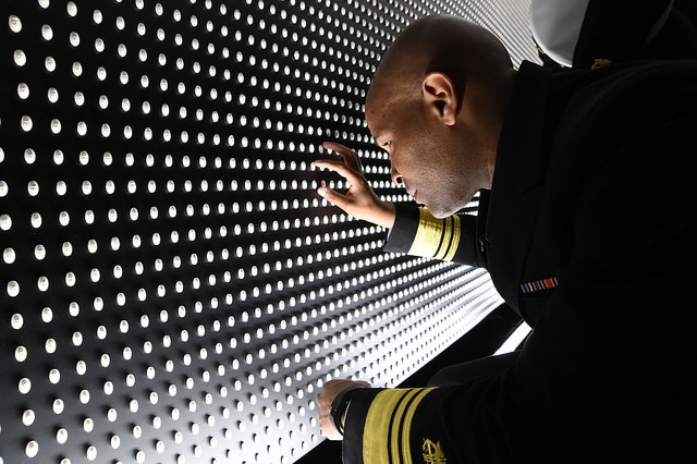 Surgeon General looks at the faces of victims of the wall.