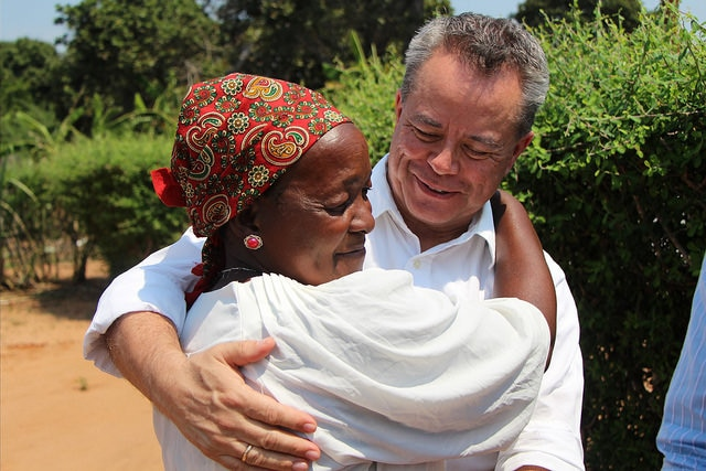 Teresa Mbalane, who has been receiving HIV treatment since 2004, with CDC Mozambique Director Edgar Monterroso. Teresa receives treatment via PEPFAR funding distributed by CDC Mozambique to the Elizabeth Glaser Pediatric AIDS Foundation.