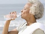 Picture of a lady drinking water from a bottle
